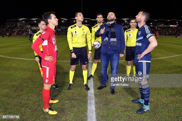 The two captains Isaas Sanchez of United Carl Valeri of the Victory are pictured with the NAB coin toss participant at the coin toss prior to the...