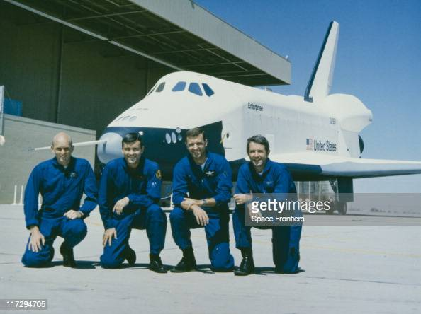The two crews of the prototype Space Shuttle Enterprise pose in front of their craft on the day of its rollout at the Rockwell International Space...