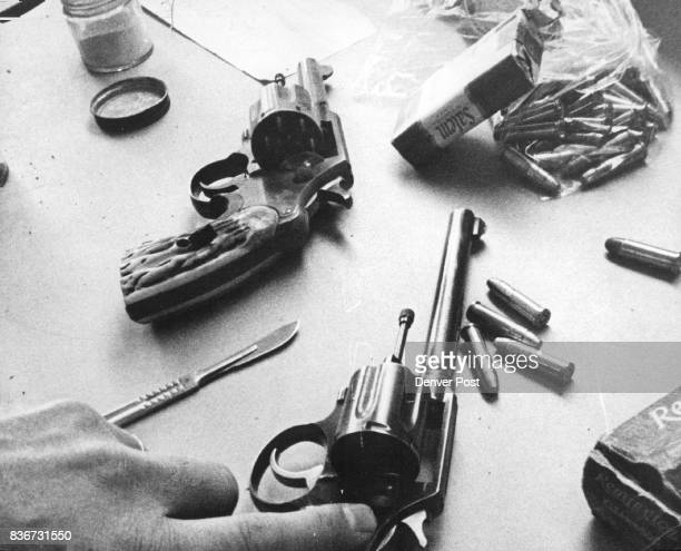 The two guns and the ammunition found in the canvas bag in the alley are shown One is a 38caliber weapon and the other a 38caliber revolver has been...