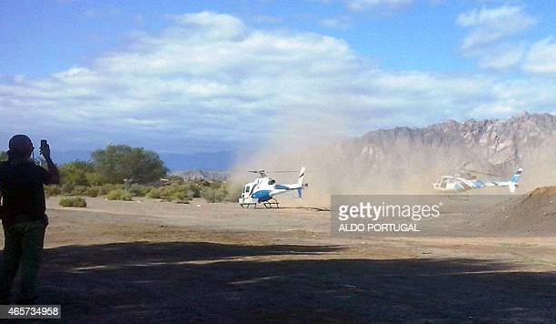 The two helicopters which collided midair near Villa Castelli take off moments before the accident in the Argentine province of La Rioja on March 9...