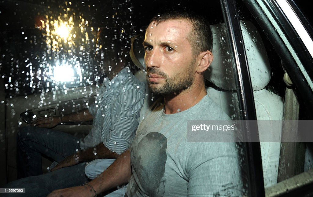 The two Italian marines accused of murdering two Indian fishermen leave after being released following a preliminary hearing on June 1, 2012 in a case that has caused a diplomatic row. Massimiliano Latorre and Salvatore Girone, who shot dead the fishermen off India's southwestern coast on February 15, appeared in the lower court in Kollam in the southern state of Kerala. The two marines deny murder, saying they mistook the fishermen for pirates. The court fixed June 18 for the next hearing and directed the state government to provide a list of interpreters 'for the benefit of the accused', the semi-official Press Trust of India news agency reported.