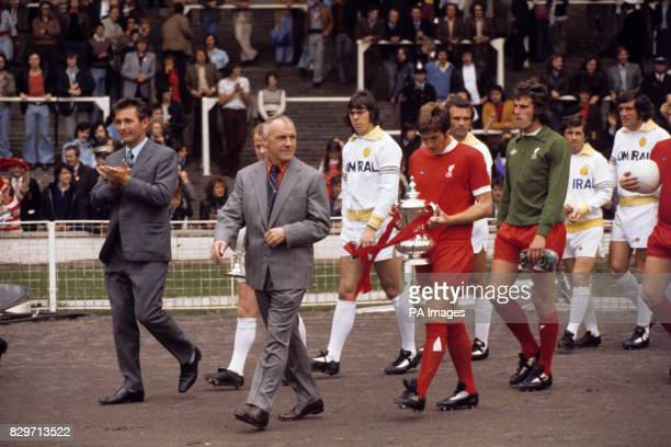 The two managers Leeds United's Brian Clough and Liverpool's Bill Shankly lead their teams out before the match Following them are the two captains...