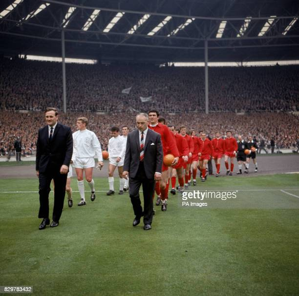 The two managers Leeds United's Don Revie and Liverpool's Bill Shankly lead their teams out onto the pitch before the match