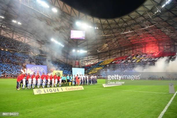 The two sides line up before the Ligue 1 match between Olympique Marseille and Paris Saint Germain at Stade Velodrome on October 22 2017 in Marseille...