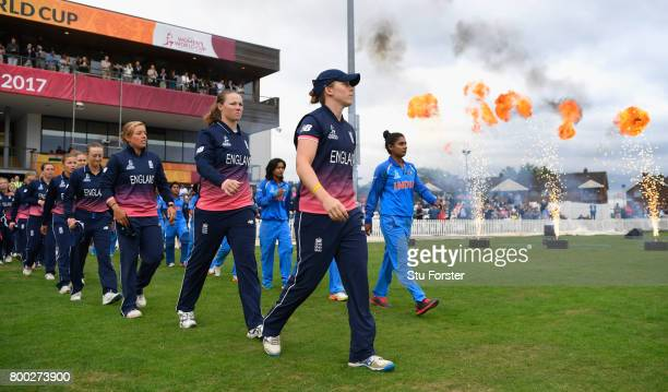 The two teams enter the field before the ICC Women's World Cup 2017 match between England and India at The 3aaa County Ground on June 24 2017 in...