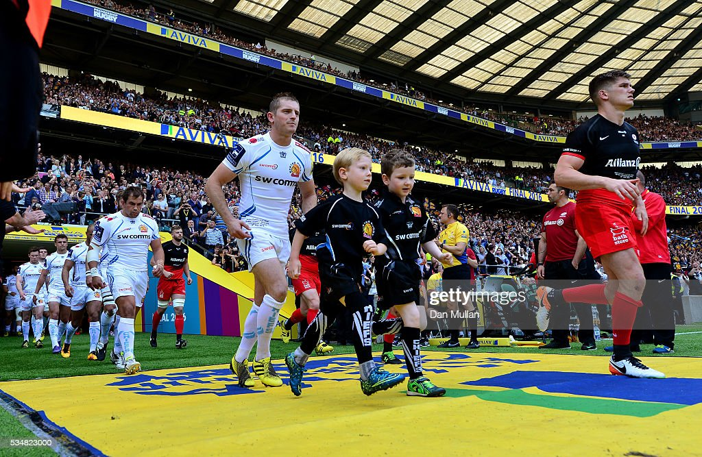 The two teams enter the field of play ahead of the Aviva Premiership final match between Saracens and Exeter Chiefs at Twickenham Stadium on May 28, 2016 in London, England.
