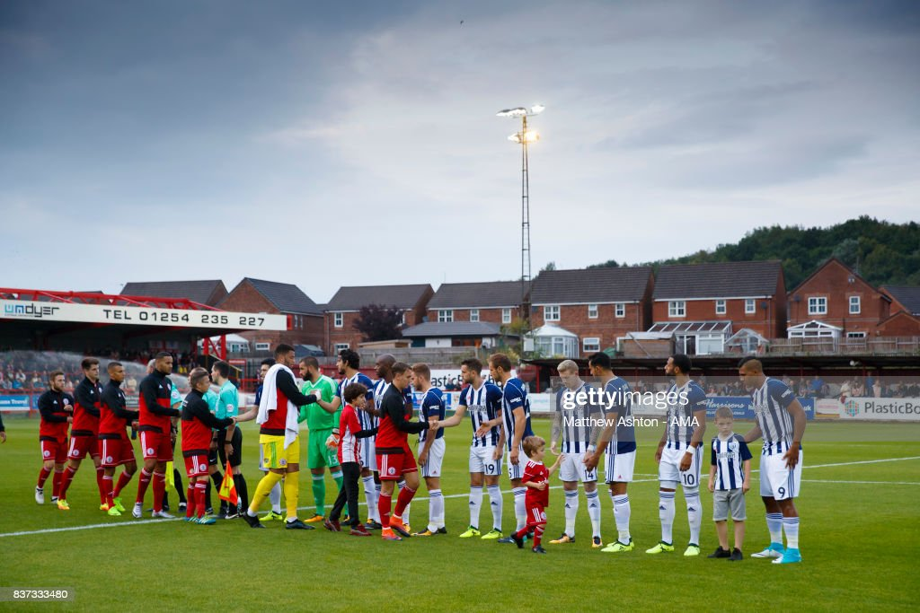 The two teams greet each other prior to of the Carabao Cup Second Round match between Accrington Stanley and West Bromwich Albion at Wham Stadium on August 22, 2017 in Accrington, England.
