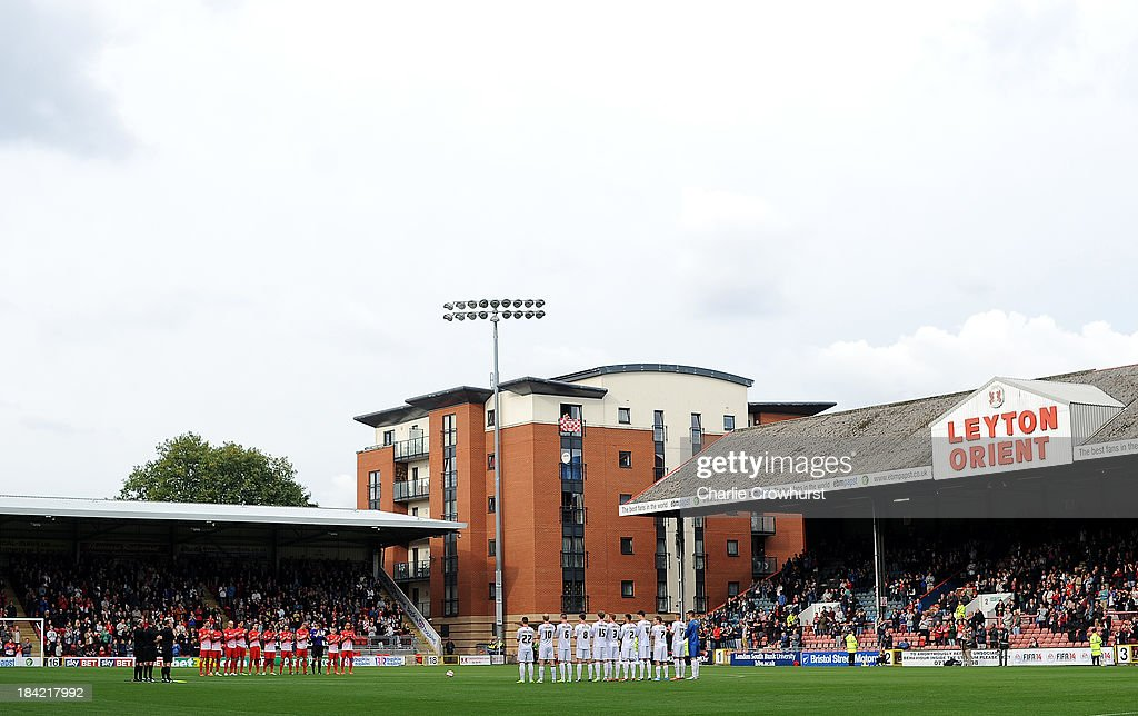 The two teams hold a minutes silence for Laurie Cunningham during the Sky Bet League One match between Leyton Orient and MK Dons at The Matchroom Stadium on October 12, 2013 in London, England.
