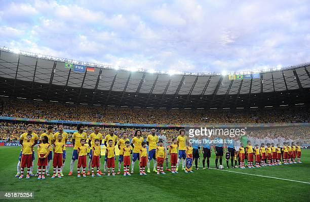 The two teams line up ahead of the 2014 FIFA World Cup Brazil Semi Final match between Brazil and Germany at Estadio Mineirao on July 08 2014 in Belo...