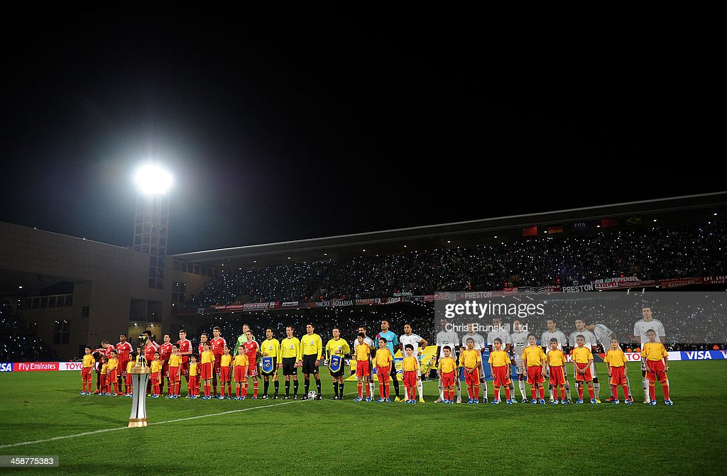 The two teams line up ahead of the FIFA Club World Cup Final match between Bayern Muenchen and Raja Casablanca at Marrakech Stadium on December 21, 2013 in Marrakech, Morocco.