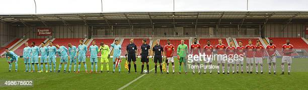 The two teams line up ahead of the UEFA Youth League match between Manchester United U19s and PSV Eindhoven U19s at Leigh Sports Village on November...