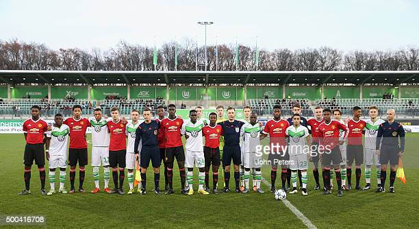 The two teams line up ahead of the UEFA Youth League match between VfL Wolfsburg U19s and Manchester United U19s at AOK Stadium on December 8 2015 in...
