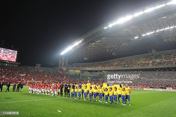 The two teams line up before the preseason Asian Tour friendly match between Urawa Red Diamonds and Arsenal at Saitama Stadium on July 26 2013 in...