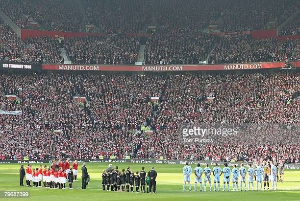 The two teams observe a minute silence in memory of the 23 victims of the Munich Air Disaster ahead of the Barclays FA Premier League match between...