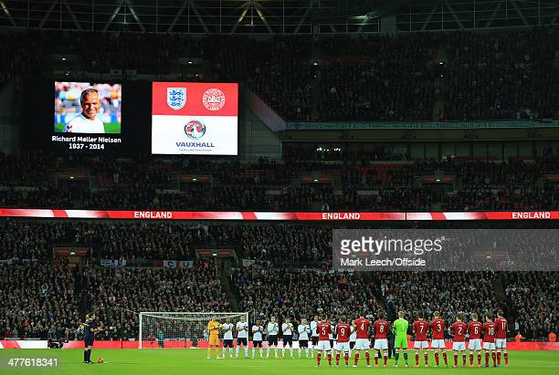 The two teams observe a minute's applause in memory of former Danish coach Richard Moller Nielsen prior to the international friendly between England...