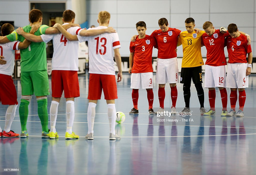 The two teams observe a minutes silence during the Futsal Interantional match between England and Poland at St Georges Park on November 14 2015 in...