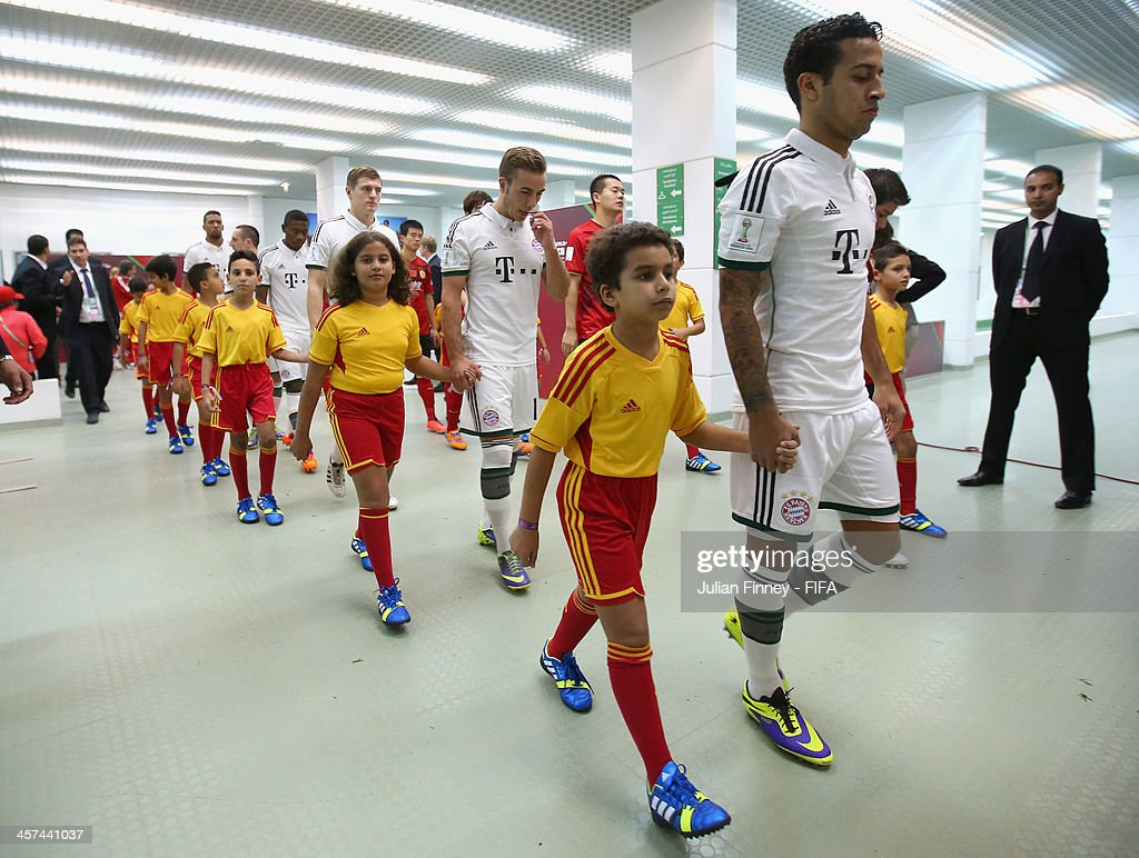 The two teams of Guangzhou Evergrande FC and Bayern Muenchen leave the tunnel before the FIFA Club World Cup Semi Final match between Guangzhou Evergrande FC and Bayern Muenchen at the Agadir Stadium on December 17, 2013 in Agadir, Morocco.