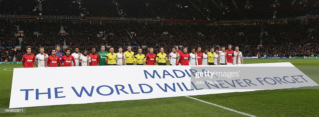 The two teams pose behind a banner paying tribute to Nelson Mandela ahead of the UEFA Champions League Group A match between Manchester United and Shakhtar Donetsk at Old Trafford on December 10, 2013 in Manchester, England.