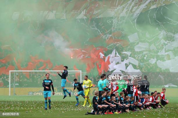 The two teams shake hands ahead of the Dutch Eredivisie match between Feyenoord and PSV Eindhoven at De Kuip on February 26 2017 in Rotterdam...