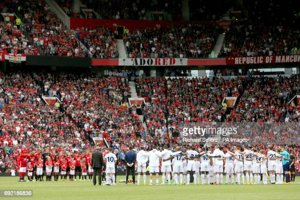 The two team's stand for a minute's silence in memory of the victims of the Manchester and London terror incidents during Michael Carrick's...