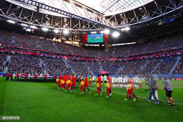 The two teams walk out ahead of the FIFA Confederations Cup Russia 2017 Final match between Chile and Germany at Saint Petersburg Stadium on July 2...
