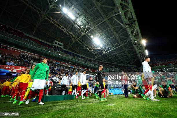 The two teams walk out ahead of the FIFA Confederations Cup Russia 2017 SemiFinal match between Germany and Mexico at Fisht Olympic Stadium on June...