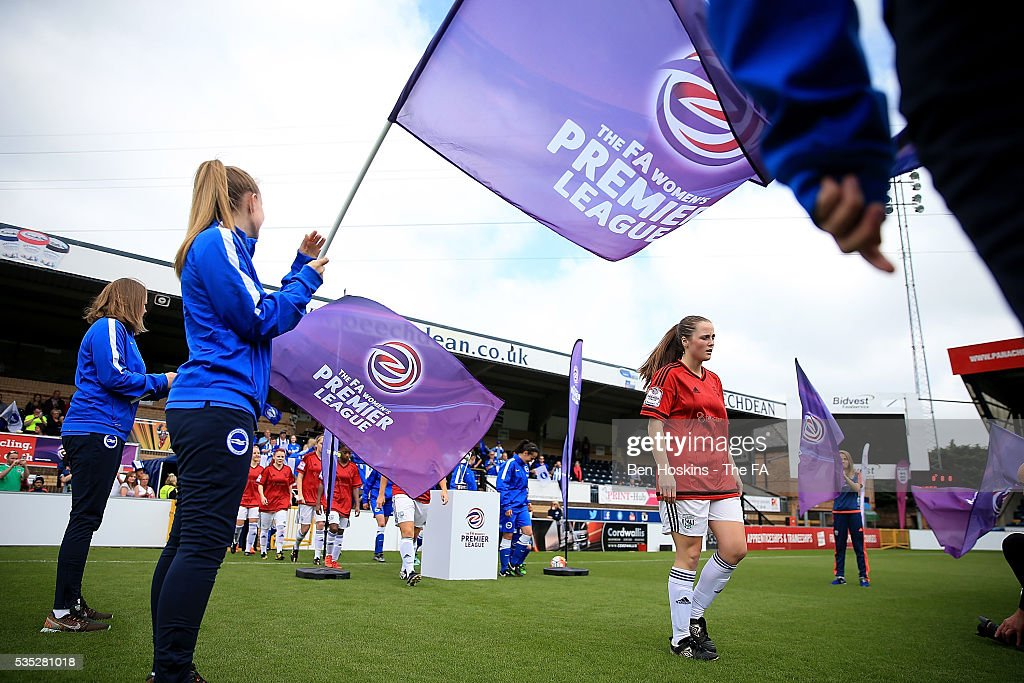 The two teams walk out ahead of the WPL Playoff match between Brighton & Hove Albion WFC and Sporting Club Albion LFC at Adams Park on May 29, 2016 in High Wycombe, England.