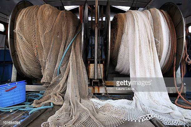 The two types of nets on a fishing boat the larger mesh size of the net on the right hand comply with new EU fishing regulations are reeled beside...