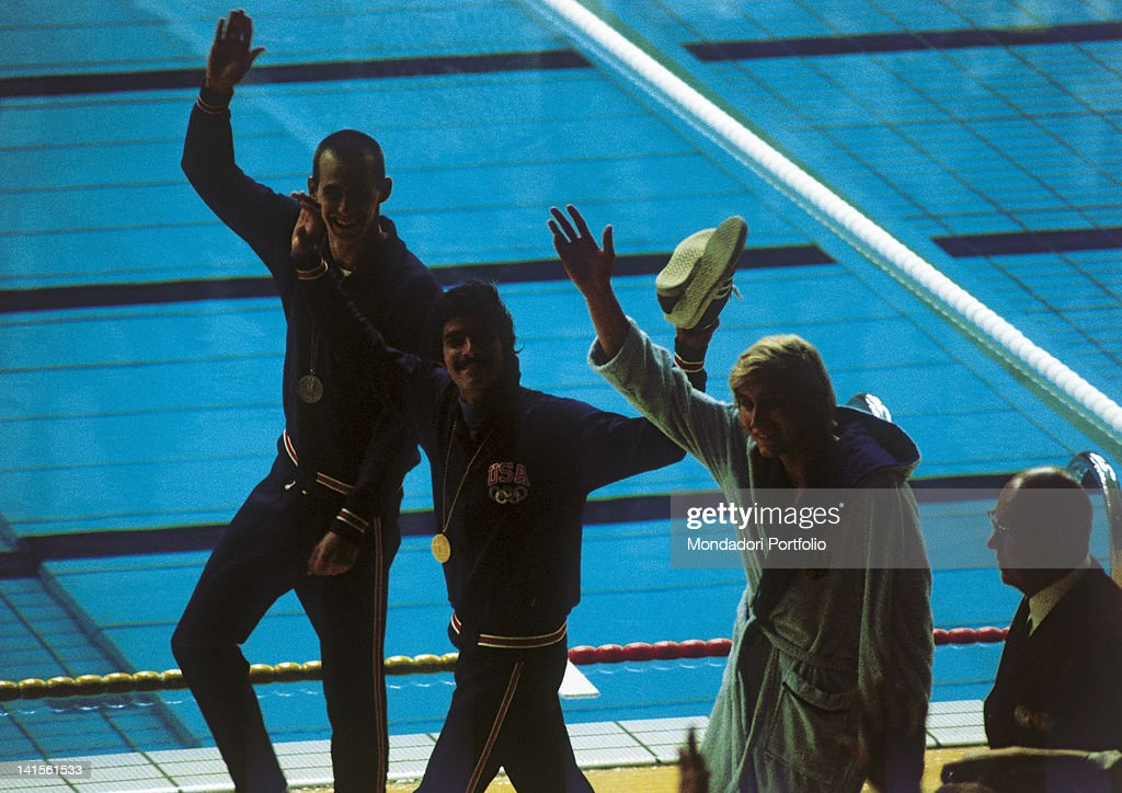The two US swimmers Mark Spitz and Steve Genter, and the German Werner Lampe greet the public after having received the medals of the final of 200 metres freestyle. Munich (Germany), August 29, 1972. This is the third of the seven final races of Spitz at the Olympic games. He won them all setting a world record.