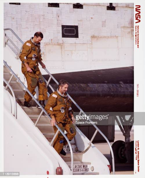The twoman crew of the Space Shuttle Columbia Richard Truly and Joe Engle disembarking from the Space Shuttle Columbia after NASA's STS2 mission...