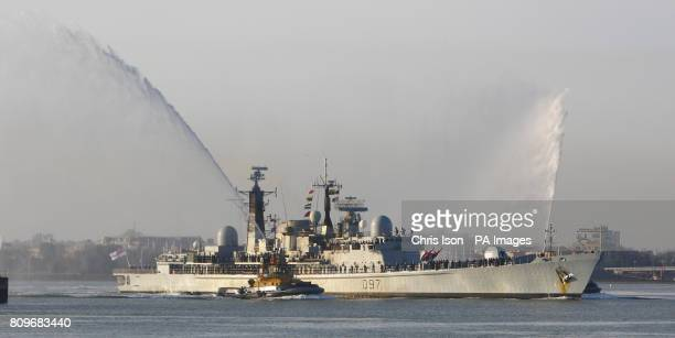 The Type 42 destroyer HMS Edinburgh returns to Portsmouth Naval Base in time for Christmas leave after its six month mission of the South Atlantic