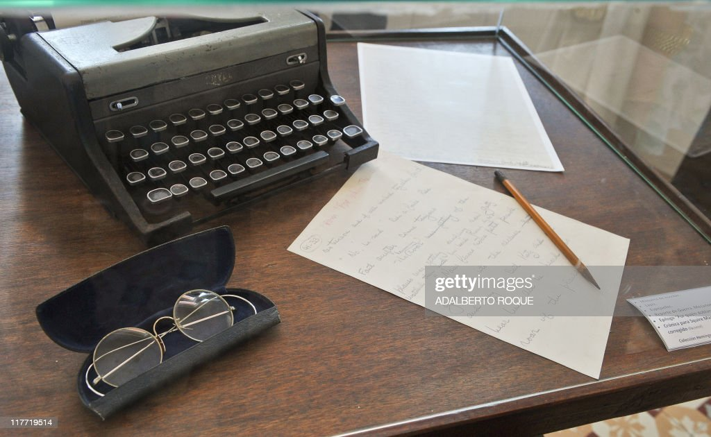 The typewriter, glasses, pencil and other items used by US Nobel Prize in Literature Ernest Hemingway in 1939, are exhibited at the Hotel Ambos Mundos in Havana, on June 16, 2011. A daiquiri at the Floridita, a mojito at the Bodeguita del Medio and an afternoon at Finca Vigia is the obligatory ritual for enthusiasts arriving in Cuba to honor the 50th anniversary of American writer Ernest Hemingway's death. In Cuba, devotees can walk in the footsteps of the Nobel Prize-winning author at destinations dedicated to Hemingway's life on the island. AFP PHOTO/ADALBERTO ROQUE
