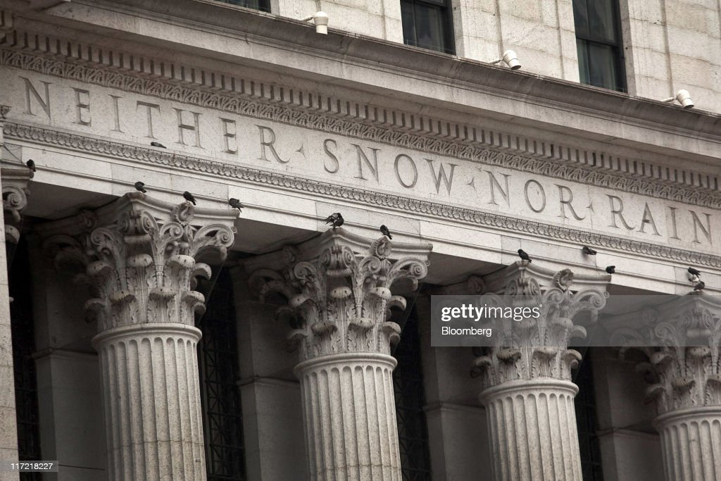 The U. S. Postal Service creed is displayed on the exterior of the James A. Farley post office building in New York, U.S., on Thursday, June 23, 2011. The U.S. Postal Service, facing insolvency without approval to delay a $5.5 billion payment for worker health benefits, will suspend contributions to an employee retirement account to save $800 million this year. Photographer: Timothy Fadek/Bloomberg via Getty Images