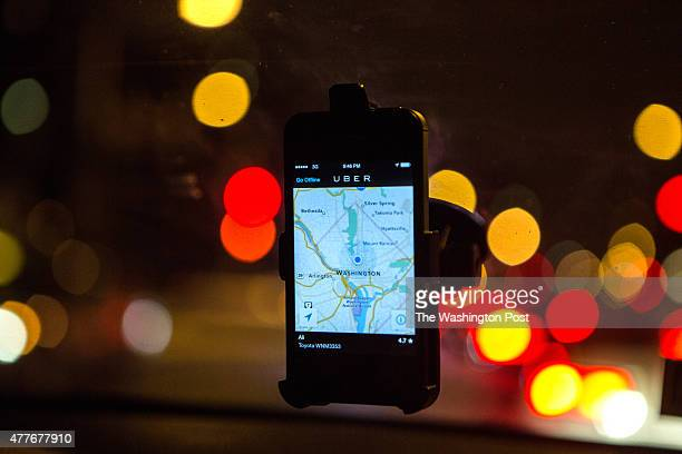 The Uber driver app on the windshield of former Washington Flyer taxi driver Ali Jaghori Jaghori now drives soley for UberX Thousands of local car...