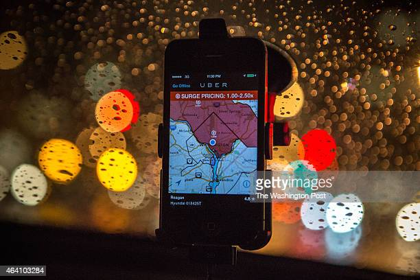 The Uber driver app on the windshield of UberX driver Regan Rucker indicates surge pricing during peak ridership on Friday night April 4 in...