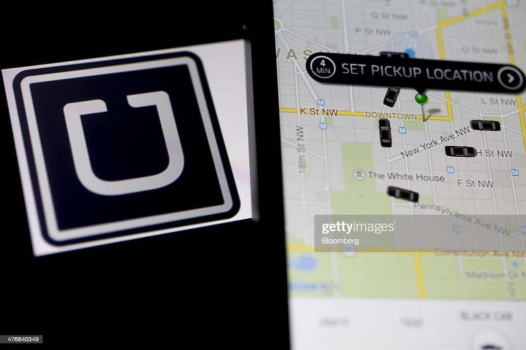 The Uber Technologies Inc. application and logo are displayed on an Apple Inc. iPhone 5s and iPad Air in this arranged photograph in Washington, D.C., U.S., on Wednesday, March 5, 2014. Uber, a startup that lets drivers pick up passengers with their personal cars and that was valued at $3.5 billion in a funding round last year, has raised $307 million from a group of backers that include Google Ventures, Google Inc.'s investment arm, and Jeff Bezos, the founder of Amazon. Photographer: Andrew Harrer/Bloomberg via Getty Images