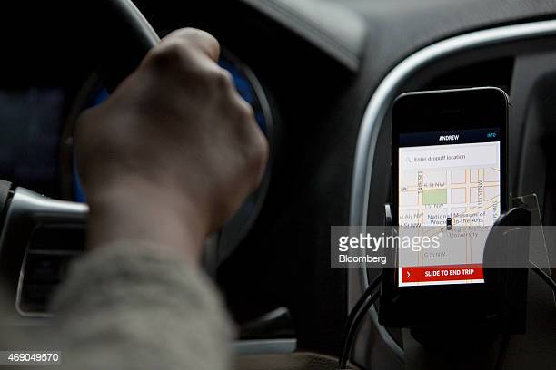 The Uber Technologies Inc application runs on an Apple Inc iPhone during an Uber ride in Washington DC US on Wednesday April 8 2015 Last month Uber...