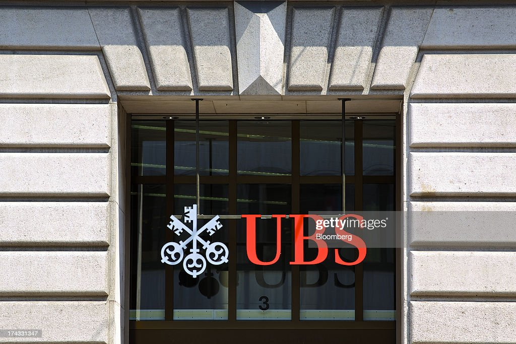 The UBS AG logo sits on display outside a branch of the bank in Basel, Switzerland, on Tuesday, July 23, 2013. Europe's biggest banks, which more than doubled their highest-quality capital to $1 trillion since 2007 to meet tougher rules, may have further to go as regulators scrutinize how lenders judge the riskiness of their assets. Photographer: Gianluca Colla/Bloomberg via Getty Images