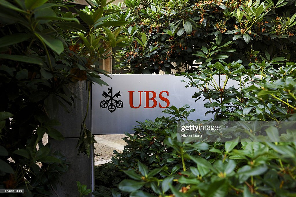 The UBS AG logo stands amongst foliage outside the bank's offices in Basel, Switzerland, on Tuesday, July 23, 2013. Europe's biggest banks, which more than doubled their highest-quality capital to $1 trillion since 2007 to meet tougher rules, may have further to go as regulators scrutinize how lenders judge the riskiness of their assets. Photographer: Gianluca Colla/Bloomberg via Getty Images