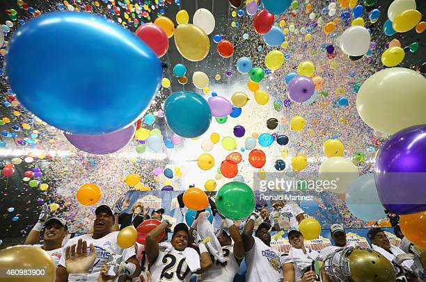 The UCLA Bruins celebrate their 4035 win against the Kansas State Wildcats during the Valero Alamo Bowl at Alamodome on January 2 2015 in San Antonio...