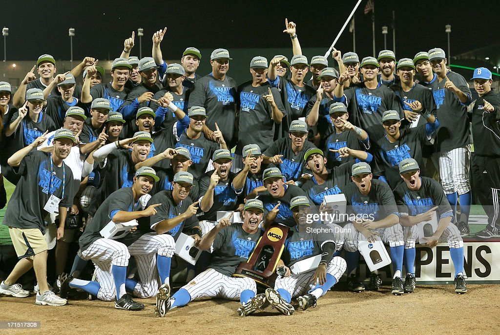 The UCLA Bruins celebrate with the championship trrophy after defeating the Mississippi State Bulldogs during game two of the College World Series Finals on June 25, 2013 at TD Ameritrade Park in Omaha, Nebraska. UCLA won 8-0 to take the series two games to none and win the College World Series Championship.