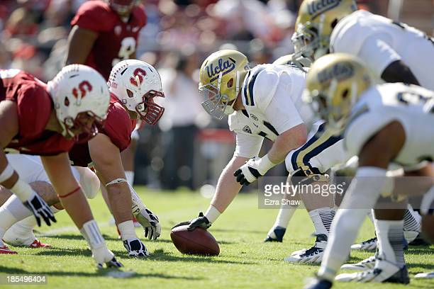 The UCLA Bruins line up against the Stanford Cardinal at Stanford Stadium on October 19 2013 in Palo Alto California