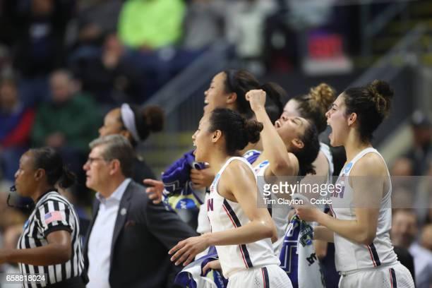 the UConn starters Katie Lou Samuelson Napheesa Collier Gabby Williams Saniya Chong and Kia Nurse of the Connecticut Huskies cheer on their bench...