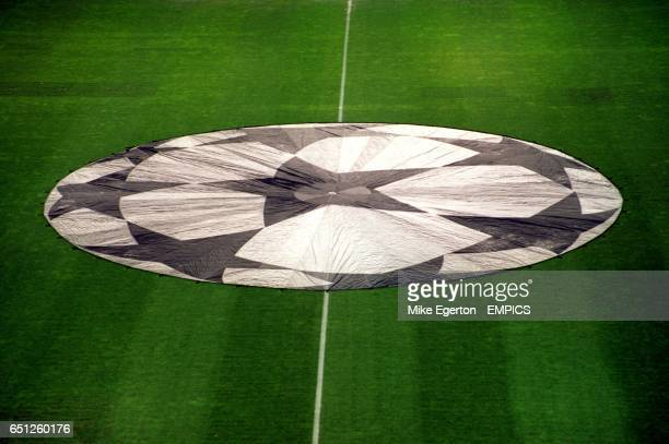 The UEFA Champions League ball star logo covers the centre circle