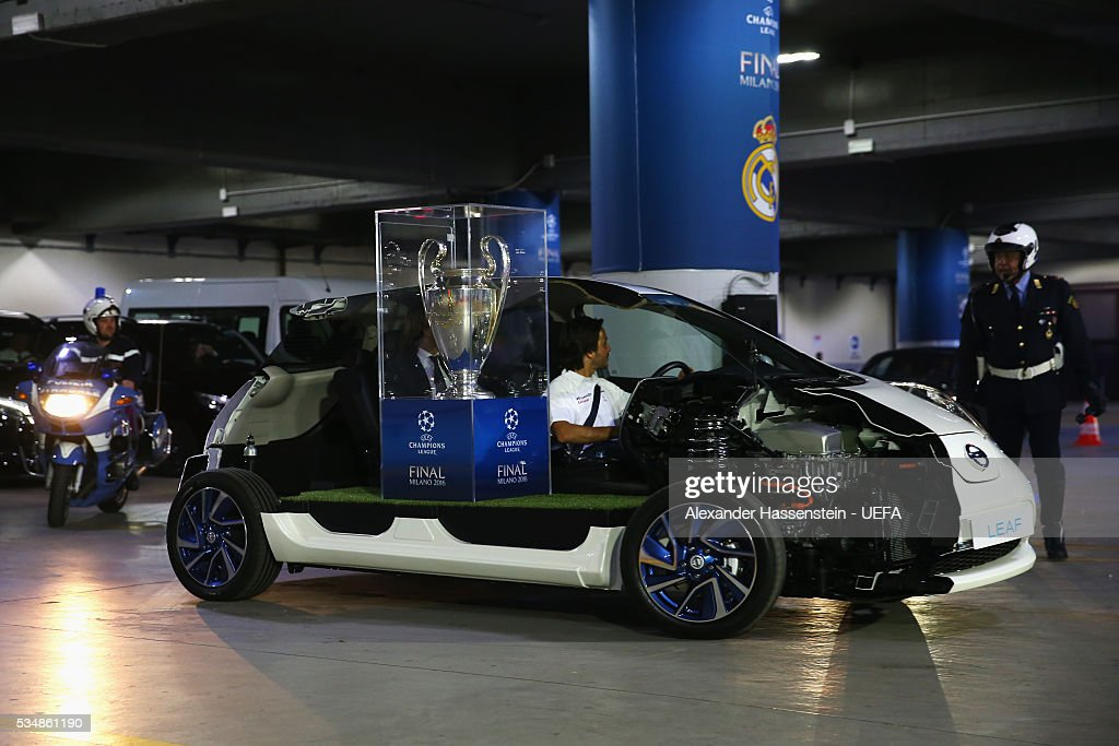 The UEFA Champions League trophy arrives prior to the UEFA Champions League Final between Real Madrid and Club Atletico de Madrid at Stadio Giuseppe Meazza on May 28, 2016 in Milan, Italy.