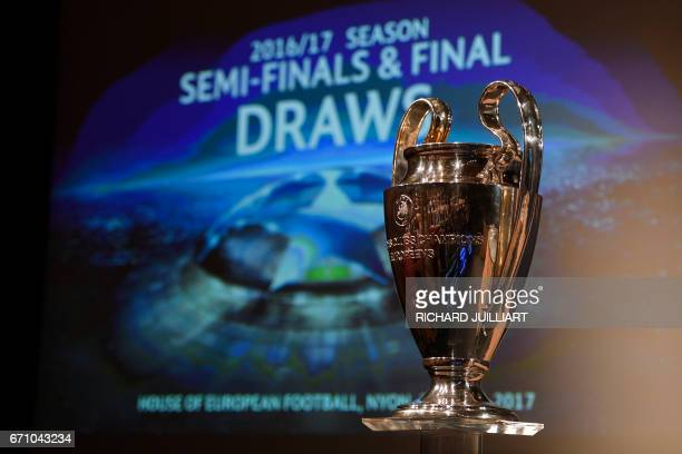 TOPSHOT The UEFA Champion's league trophy is displayed ahead of the draw for the football competition's semifinals on April 21 2017 in Nyon / AFP...
