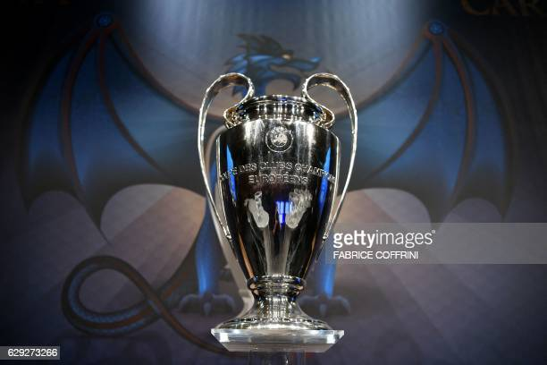 The UEFA Champions League trophy is displayed before the round of 16 draw of the UEFA Champions League football tournament at the UEFA headquarters...
