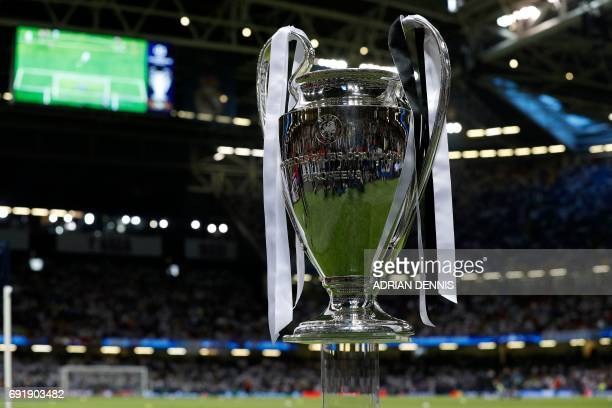 The UEFA Champions League trophy is pictured beside the pitch ahead of the UEFA Champions League final football match between Juventus and Real...