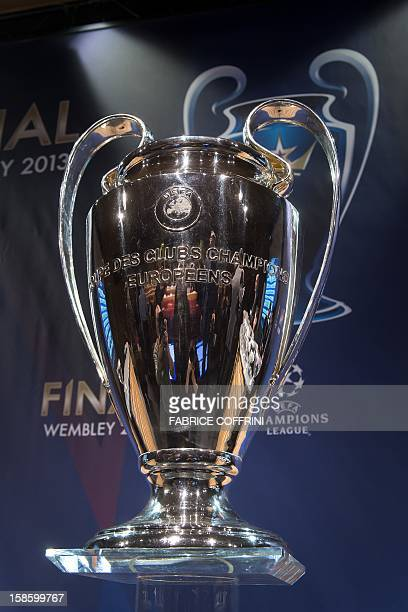 The UEFA Champions League trophy sits on a pedestal during the draw for the last 16 of the UEFA Champions League on December 20 2012 at the UEFA...
