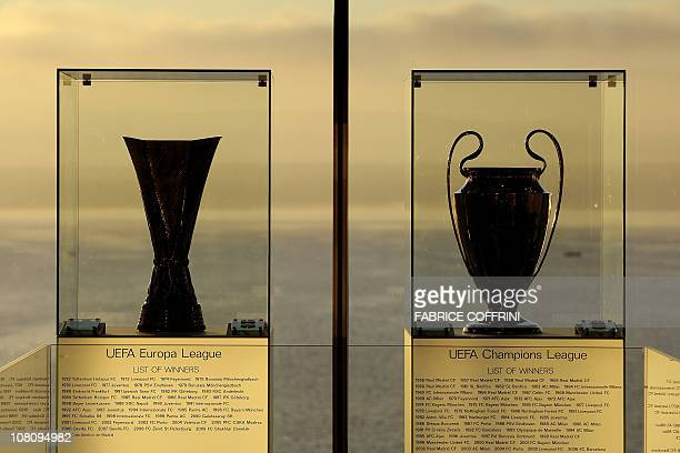 The UEFA Europa League trophy and the UEFA Champions League trophy are seen prior to a meeting of the European football governing body UEFA on...
